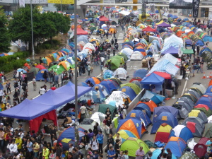 As far as the eye can see young Hong Kong people set up camp in the central business district