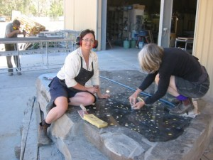 Mosaic artist, Helen Bodycomb, putting the finishing touches to the Victorian memorial at Castlemaine